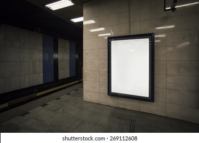 Realistic photo blank billboard in metro station (Prague, Czech Republic), with the texture of the poster and highlights