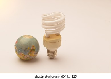 Realistic photo image of light bulbs. Fluorescent bulbs and globe with  white energy saving bulb and free copy copy space. Filter light bulb.