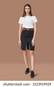 Realistic studio photo apparel mockup with real model wearing in white t-shirt for shirt design presentation standing on trendy colour background
