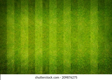 A realistic textured grass football , green natural grass of a soccer field