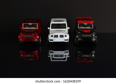 Realistic unnamed cars on a black mirror background. battle. Kids toys. Competitions.