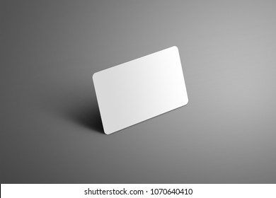 Realistic white mockup one  bank (gift) card with shadows on a gray background. Ready to used in your design.