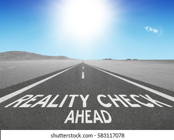 Reality Check Ahead warning written on highway