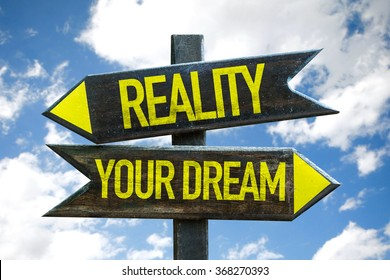 Reality - Your Dream signpost in a beach background