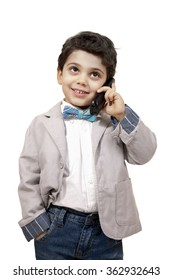 Really young boy is pretending like a businessman while dealing business over the phone.