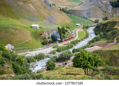 Realp, Furka - July 15, 2018: the vintage steam train going through the Raelp valley in Canton Uri, Switzerland