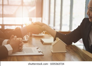 realtor & client handshaking. real estate agent shaking hands with customer. sale & purchase property with signing contract document and approved mortgage loan