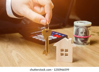 Realtor holds house keys. Real estate agent. Buying and selling a house, apartment. Home. Affordable housing. Investment in construction. Planning a new project. Property valuation. Selective focus