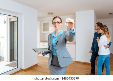 Realtor showing keys to new apartment giving the client a tour