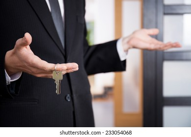 Realtor's hand holding keys to new home