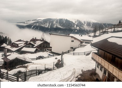 realy small Tesselberg settlement (part of Gais village) in Riesenferner mountainsabove Pustertal valley in Italy during winter cloudy day with Kronplatz peak on the background