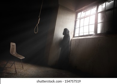 The reaper Waiting a despair man in an abandoned place with a Hangman Noose