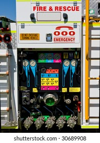 Rear of an Australian fire truck, showing various dials, levers and controls