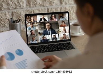 Rear back view female employee analyzing marketing research report holding video conference call brainstorming meeting with happy multiracial teammates colleagues and leader online from home. - Shutterstock ID 1854695932
