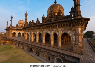 The rear of the beautiful Ibrahim Roza mausoleum on a clear sunny, blue sky day in Bijapur, India, the precursor and inspiration for the Taj Mahal of Agra