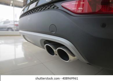 Rear car bumper, black. Muffler