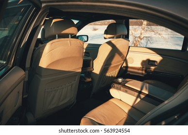 rear of the car interior leather seats in the sun