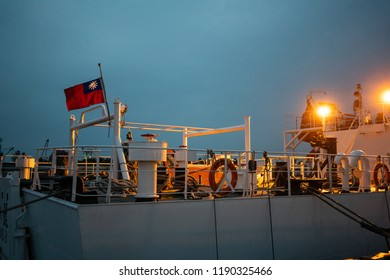 Rear of a coastguard boat with flag of Taiwan at sunset