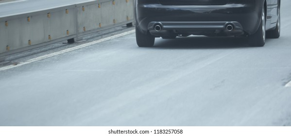 Rear and exhaust of a car on the highway