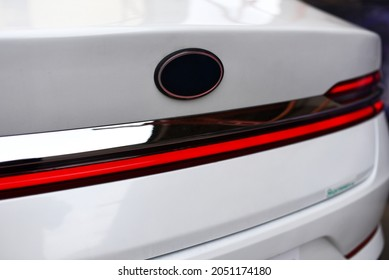 Rear LED headlamp of a modern car. Brake taillight. Red stop lighting of highway vehicles. Cars ambient lighting. Cars taillight decorative frame ABS plastic