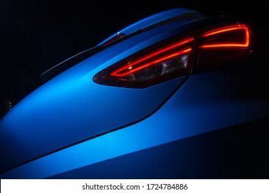 Rear light of modern dynamic car. Red LED light