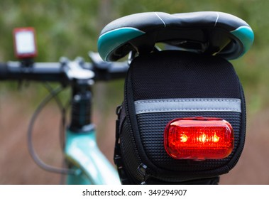 Rear lights of a bicycle, necessary in the dark.