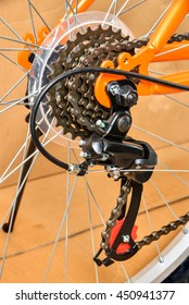 Rear mountain bike gears cassette on the wheel with chain (selective focus)