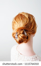Rear portrait of strawberry blond red hair bride woman with romantic hairdo decorated with diamond jewellery, healthy hair care beauty, indoors. Wedding hair treatment cosmetics perfect hair dressing.