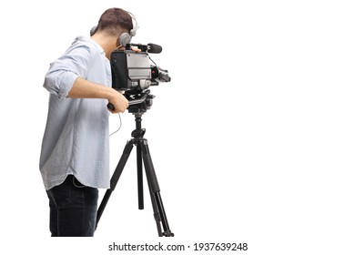 Rear shot of a cameraman recording with a professional camera on a stand isolated on white background