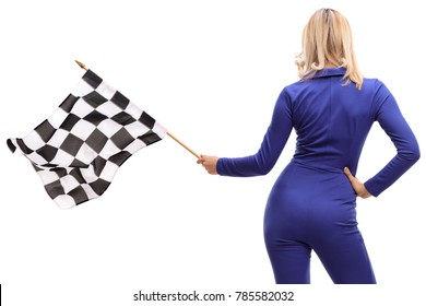 Rear shot of a woman in a racuing suit waving a checkered race flag isolated on white background