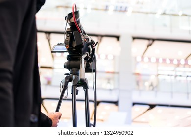 Rear side of Video Cameraman taking recording film photograp to stage in Live streming event and seminar hall. Media Production equipment concept
