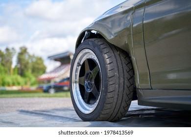 Rear side view front wheel of black car