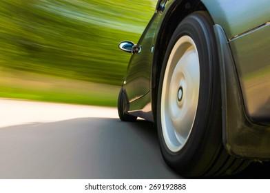 Rear side view of speeding car.