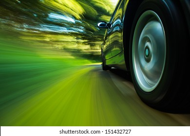 Rear side view of sport car with heavy blurred motion.