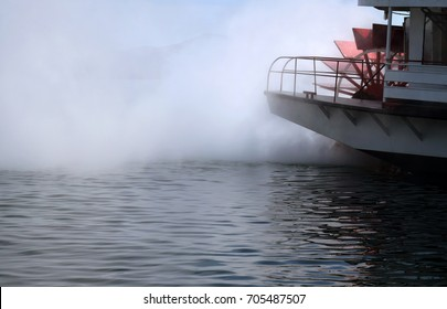 Rear of a steamer paddle boat on the water