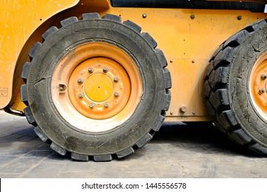 A rear tyre, heavy duty construction site diesel excavator.