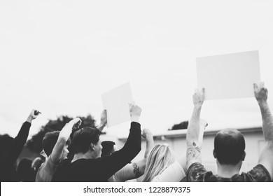 Rear view of activists showing papers while protesting