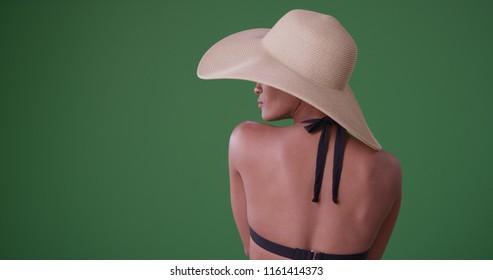 Rear view of african american woman in sunhat and bikini on green screen