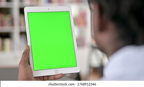 Rear View of African Man using Tablet, Chrome Key Screen