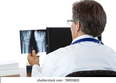 Rear view of an aged radiologist examining radiography image .Isolated on white background.