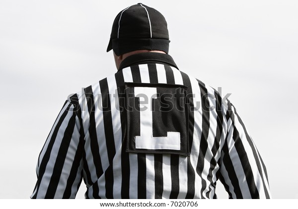 Rear view of American football line judge during a game.