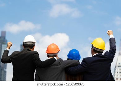 Rear View of Asian Business People or Engineer Team Success construction project,Achievement Arm Raised or Celebration Togetherness Happiness company with happy workers Outside Office.
