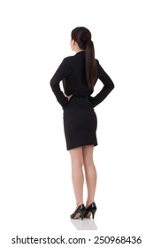 Rear view of Asian business woman, full length portrait with reflection on studio white background.