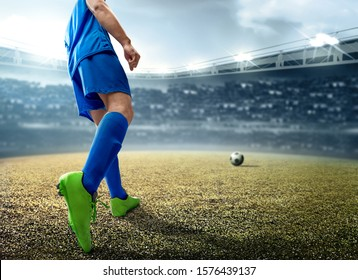 Rear view of Asian football player man kicking the ball on the football field at the stadium