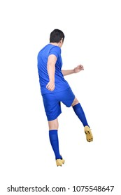 Rear view of asian footballer man shooting the ball posing isolated over white background