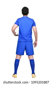 Rear view of asian soccer player in blue jersey standing isolated over white background