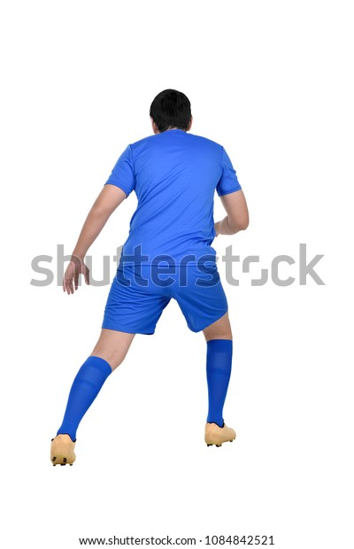 Rear view asian soccer player in action isolated over white background
