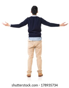 Rear view of Asian young man open arms and feel free, full length portrait.