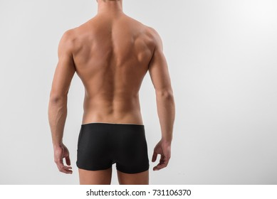 Rear view of attractive naked guy