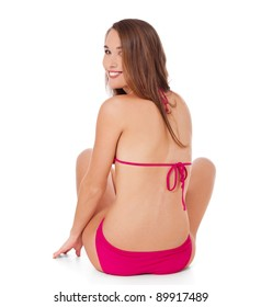 Rear view of an attractive young woman in bikini. All on white background.